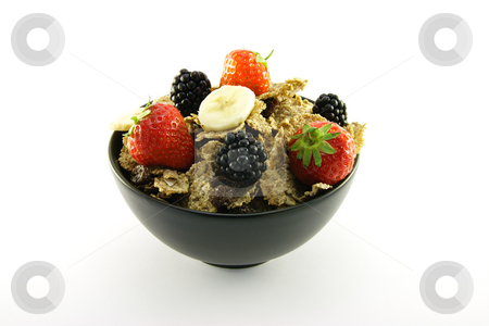 Bran Flakes in a Black Bowl stock photo, Crunchy looking delicious bran flakes and juicy fruit in a black bowl on a white background by Keith Wilson
