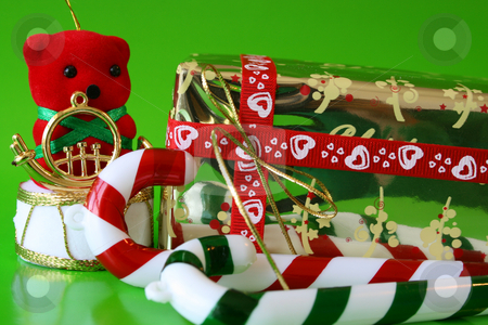 Christmas Decorations stock photo, Christmas Decorations and a gold wrapped gift by Vanessa Van Rensburg