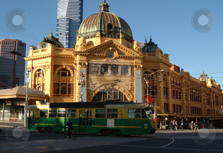 Flinders Street Station stock photo, The entrance to Melbourne's Flinders Street Station with a classic tram passing in front by Lee Torrens