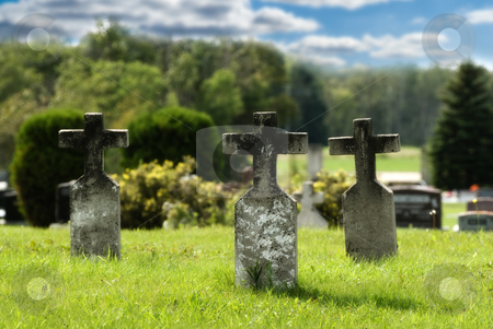 Three Graves stock photo, Three graves with crosses situated in a small graveyard, done in vibrant colors to signify peace by Richard Nelson