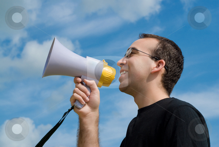 Man With Megaphone stock photo, A low angle view of a man talking into a megaphone with the sky behind him by Richard Nelson