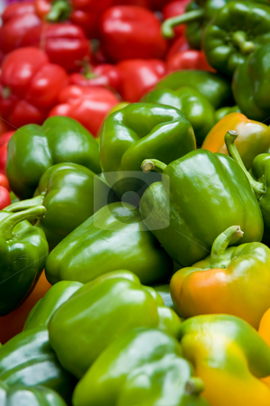 Red, green and yellow peppers stock photo, Close of of red, green and yellow peppers in a marketplace by Gabriele Mesaglio