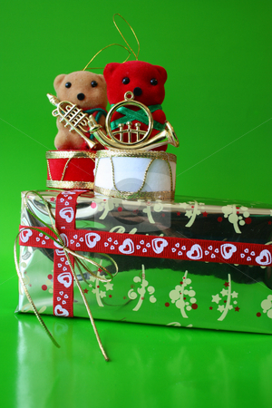 Bears on Gift stock photo, Christmas decoration Teddy Bears on a gold wrapped gift by Vanessa Van Rensburg
