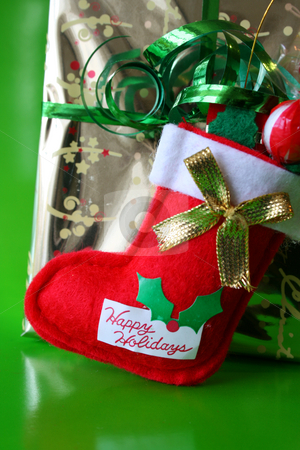 Christmas Stocking stock photo, Christmas stocking against a gold wrapped present by Vanessa Van Rensburg