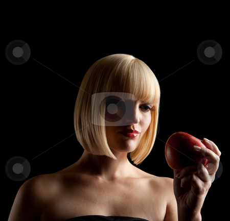Blonde Woman's Silhouette stock photo, The silhouette of a beautiful blonde woman.  She is holding an apple. Square framed photograph. by Media Deva
