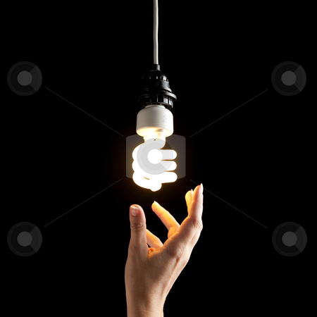 Hand and Lightbulb stock photo, A hand about to touch a lightbulb. Square framed shot. by Media Deva