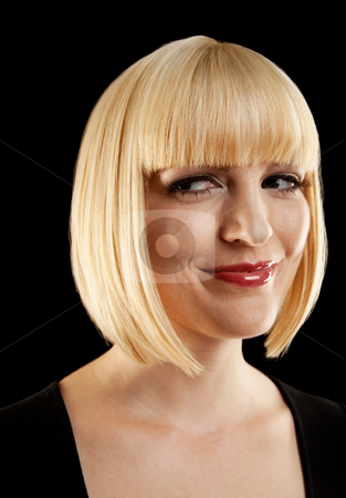 Beautiful Blonde Staring stock photo, The headshot of a beautiful blonde. She has a smirk on her face and is looking to the side. Vertically framed photo. by Media Deva