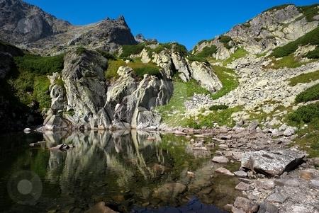 Colorfull stones by mountain lake stock photo, Mountain lake scenery with colorful stones by Juraj Kovacik