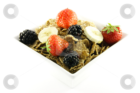 Bran Flakes in a White Bowl stock photo, Crunchy delicious looking bran flakes and juicy fruit in a white bowl on a white background by Keith Wilson