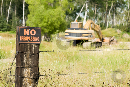No Trespassing stock photo, No trespassing at this work site featuring the sign and an excavator by Richard Nelson