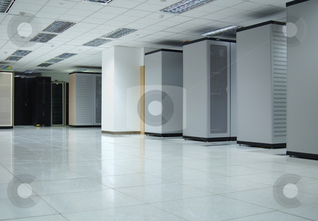 Computer Data Center Interior stock photo, Interior of a data center where servers and computers are securely hosted by Lee Torrens