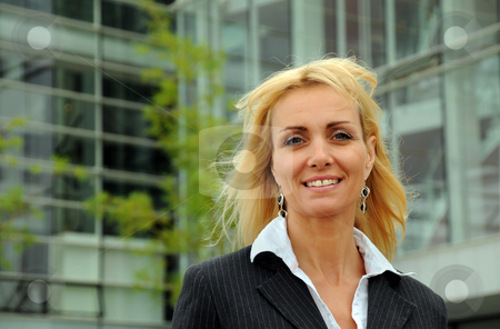 Business Outside 5 stock photo, Business woman standing in front of office building - smiling by Tony Lott N??rnberger