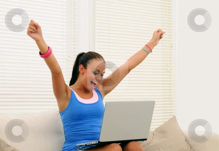 Big victory stock photo, Young woman winning on laptop by Tony Lott N??rnberger