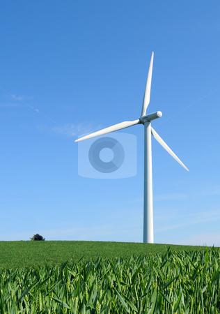 Alone in the wind stock photo, Single windturbine in crop field by Tony Lott N??rnberger