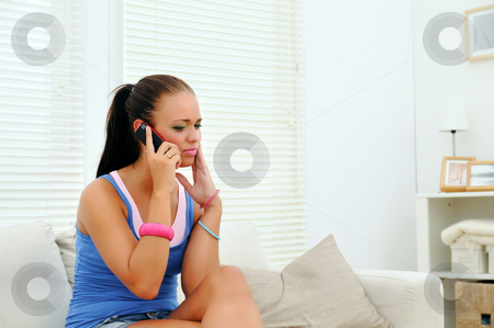 Bad news stock photo, Young woman getting bad news on cellphone by Tony Lott N??rnberger