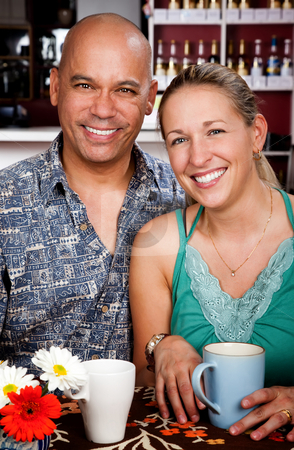 Couple in Coffee House stock photo, Attractive man and woman posing in a coffee house by Scott Griessel