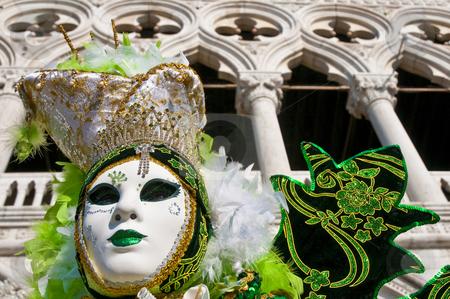 Venice Carnival 2009 stock photo, With Il Palazzo Ducale as backdrop, the masked participants walk along the Riva degli Schiavoni. by Anibal Trejo