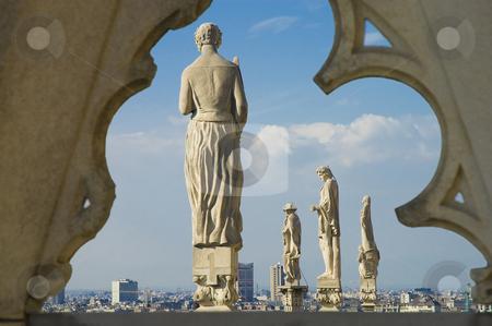 Il Duomo di Milano stock photo, Statues at the roof of Il Duomo di Milano, the fourth-largest church in the world. by Anibal Trejo