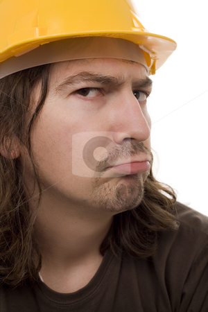 Worker stock photo, Young construction worker face with yelow helmet by Marc Torrell
