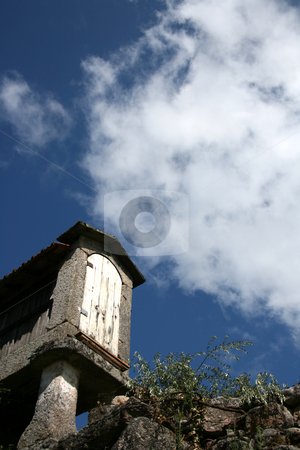 Blue sky  stock photo, Small constructuin typical from nord of portugal on a blue sky by Marc Torrell