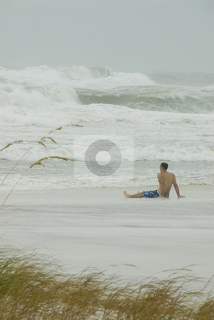 Lone Gustav Spectator stock photo, PENSACOLA - SEP 1: A man watches the pounding surf during Hurricane Gustav on September 1, 2008.  Gustav made landfall in Lousiana 1 mph below a Cat 3. by A Cotton Photo