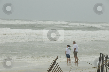 Gustav Beach Goers stock photo, PENSACOLA - SEP 1: Beach goers experience the storm power during Hurricane Gustav on September 1, 2008. Gustav winds reached a max of 150mph. by A Cotton Photo