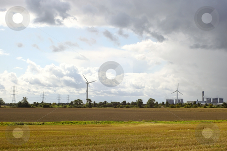 Power generation stock photo, Wind turbines next to a coal fired power station under a stormy sky by Mike Smith
