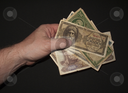 ForeignCurrencyPayment stock photo, A Hand Paying for goods in Foreign currency by Stephen Clarke