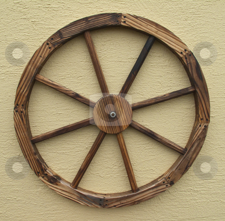 Wagon Wheel stock photo, A decorative wagon wheel isolated on a wall by Stephen Clarke