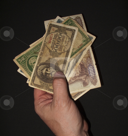 Paying for Goods stock photo, A Hand Paying for goods in Foreign currency by Stephen Clarke