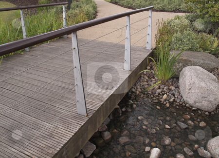 Bridge over a rockery stock photo,  by Stephen Clarke