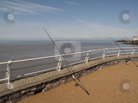 FishingRodsonPier stock photo, Some Fishing Rods at the end of a Pier in Weston Super Mare by Stephen Clarke