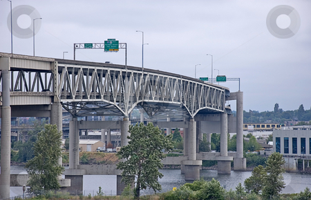 Large Concrete Bridge Structure stock photo, This large concrete bridge structure is curved in pattern with traffic crossing. by Valerie Garner