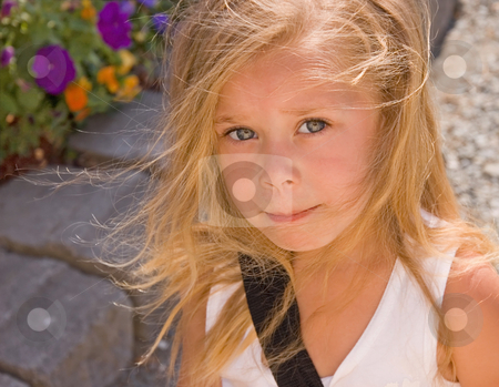 Cute Four Year Old Girl stock photo, This cute 4 year old bi-racial girl is outdoors with her blond hair wisping around her cute face. by Valerie Garner