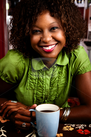 Pretty African American Woman stock photo, Pretty African American Woman in Bright Green Blouse by Scott Griessel
