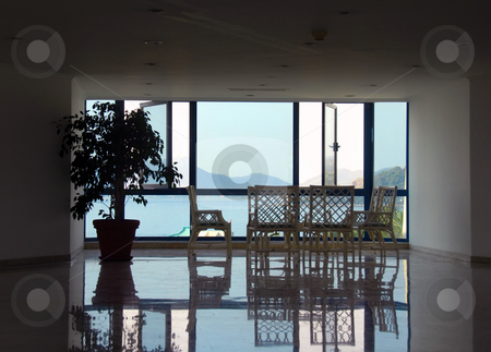Hotel interior stock photo, Hotel lobby on seaside in Turkey, chairs and table by window by Julija Sapic