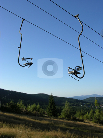 Chair-lift and the blue sky stock photo, Chair-lift and the blue sky by Robert Biedermann