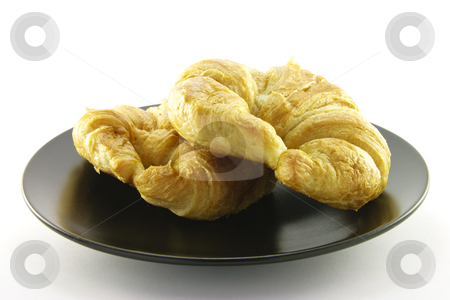 Two Croissants on a Black Plate stock photo, Two golden flakey delicious baked croissant on a black plate with a white background by Keith Wilson