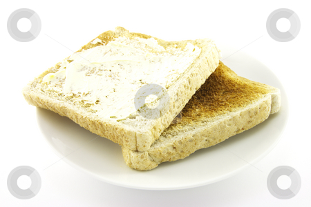 Toast on a White Plate stock photo, Crunchy lightly browned toast on a round white plate with a white background by Keith Wilson