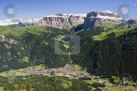 Canazei stock photo, Aerial view of Canazei and Fassa valley with Saas Pordoi mount (Sella group), Pordoi pass and Sella pass by ANTONIO SCARPI