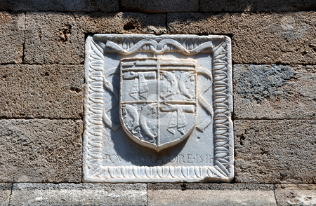 Shield on the walls of the Rhodes medieval fortress. Greece. stock photo, Detail of medieval shield, Rhodes fortress, Greece. by Fernando Barozza