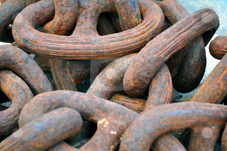 Giant rusty chain stock photo, Detail of a rusty anchor chain at port by Fernando Barozza
