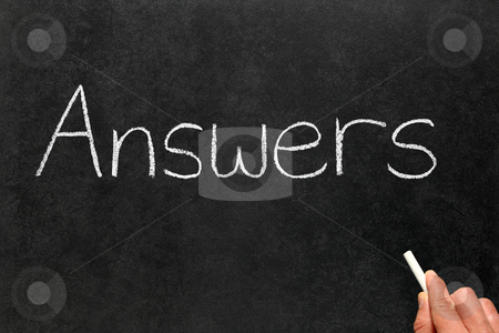 Writing answers on a blackboard. stock photo, Writing answers on a blackboard. by Stephen Rees