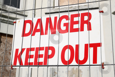 Danger keep out sign on a wire security fence. stock photo, Danger keep out sign on a wire security fence. by Stephen Rees