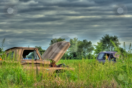 Wrecked Vehicles in HDR stock photo, Old wrecked vehicles abandoned in field done in HDR by Dennis Crumrin