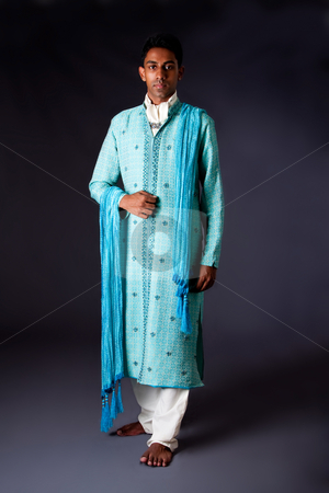 Hindu groom stock photo, Beautiful authentic Indian hindu man in typical ethnic groom attire. Bengali male wearing a light blue agua decorated Dhoti with shawl. by Paul Hakimata