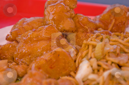 Sweet & Sour Chicken stock photo, This dish is the Chinese food sweet and sour deep fried chicken with some chow mein to the side. by Valerie Garner
