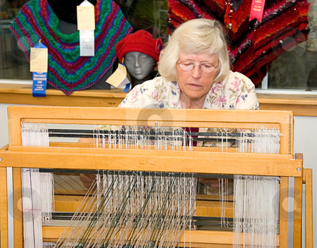 LYNDEN, WA - August 19, 2009 - Jane Doe Weaving At Fair stock photo, LYNDEN, WA - August 19, 2009 - Jane Doe is demonstrating at a live event at Lynden Fair recently the use of a textile loom by this senior aged woman.  Temps recently hit in the triple digits. by Valerie Garner