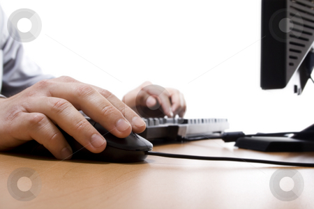 Businessman working on computer stock photo, Closeup of businessman working on desktop computer over white background, focus on hand on mouse by iodrakon