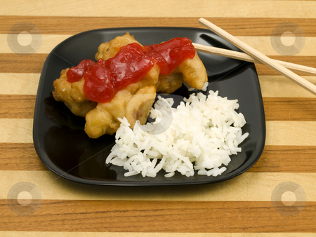 Sweet and Sour Chicken stock photo, Sweet and Sour chicken with white rice by John Teeter